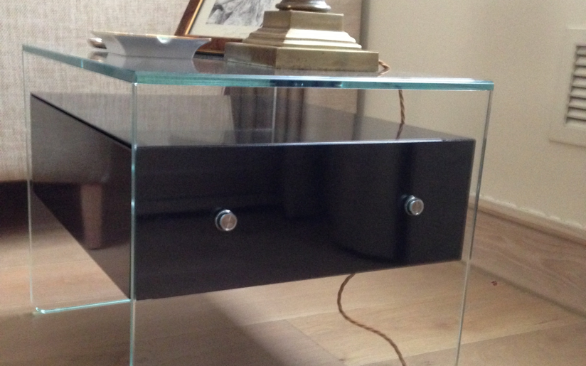 Side Table...from bonded low iron content glass with handmade and polished bespoke black high gloss hidden floating drawer unit.